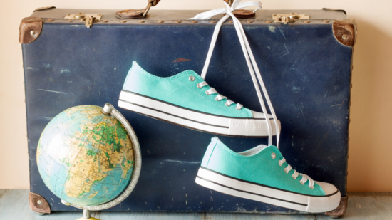 the best travel shoes in front of a suitcase