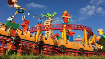 slinky dog dash roller coaster goes past a giant jessie