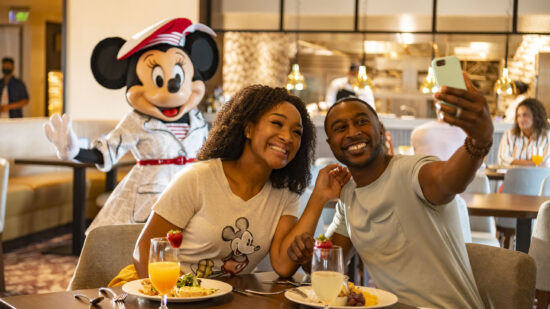 Disney for adults - a couple eating breakfast with Minnie Mouse