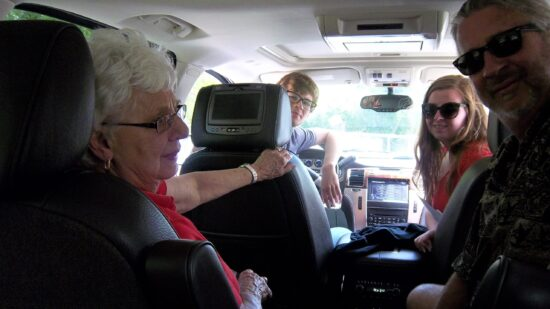 family in a car on a road trip