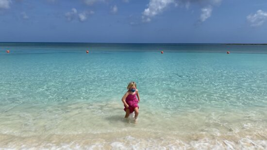 Girl in the ocean wearing a face mask at the Atlantis resort.