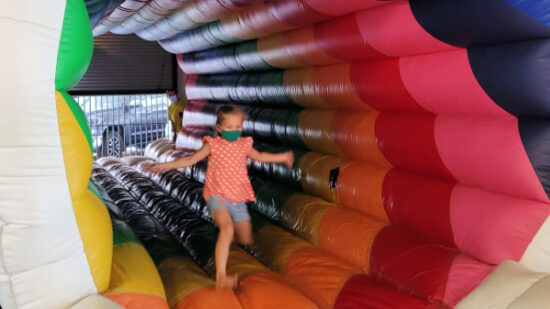 A girl bounces through the Missing Link rainbow at the New Children's Museum in San Diego