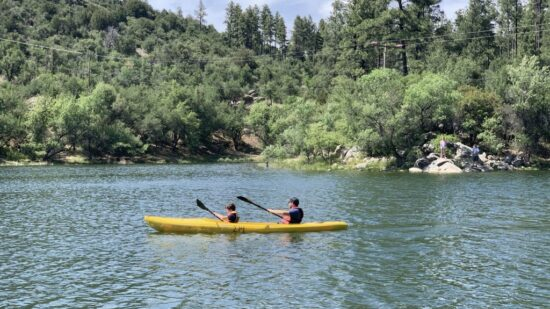 Father and son kayaking on Goldwater Lake, one of the fun things to do in Prescott AZ
