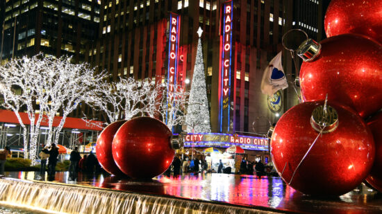 Large red Christmas ornaments on fountain plaza in front of Radio City Music Hall in NYC