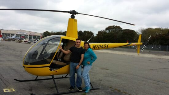 Fran and Spencer Capo pose in from of the helicopter Spencer will use to learn to fly. Photo courtesy of Fran Capo/Adventure TravelingMom