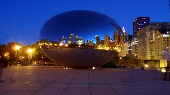Chicago's iconic lakefront statue, The Bean, at night in Millennium Park.