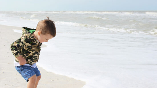 Kids have a blast splashing in the water at the beach at The Naples Grande. Photo Credit: Hannah Rinaldi, Fabulously Frugal TravelingMom