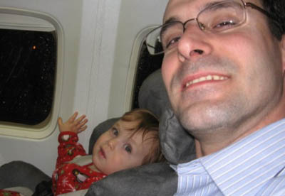 Dad and baby on their first plane ride