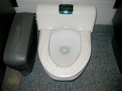Self-cleaning toilet at O'Hare had a plastic seat cover that dispenses automatically.
