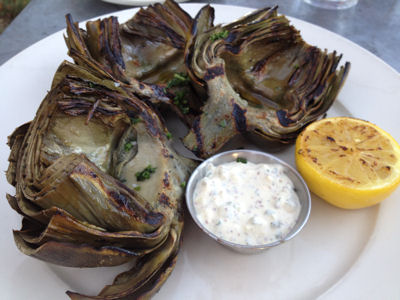 Wood grilled castroville jumbo artichoke with sauce gribiche and lemon